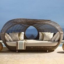 Contemporary wicker patio furniture on a modern patio.
