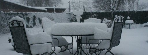 patio-furniture-covered-in-snow